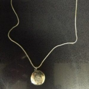 "Gold tone round locket and 18"" necklace"